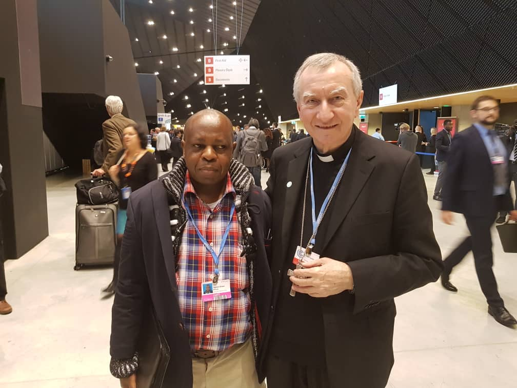Père Minani et le cardinal Parolin